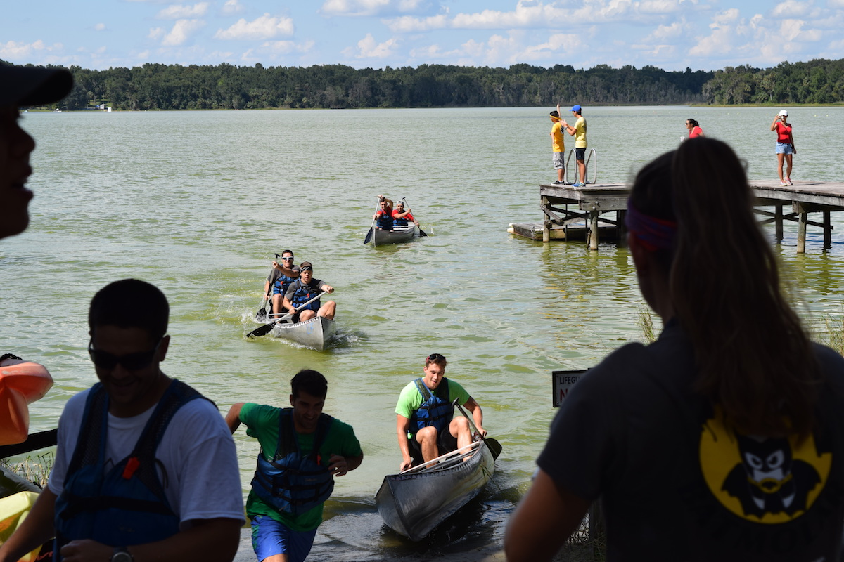 Students compete in relay race at UF's Lake Wauburg.
