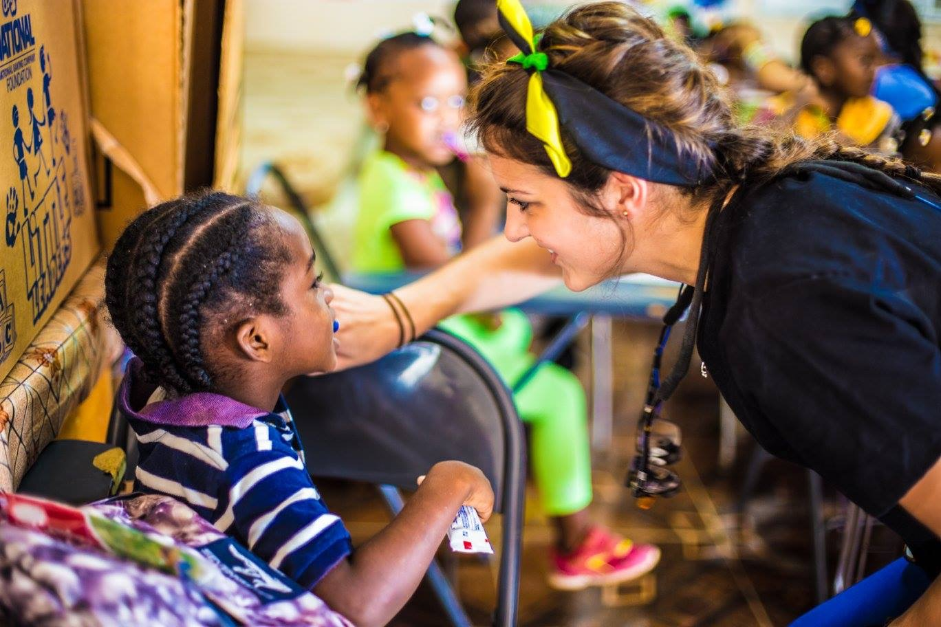 UF College of Dentistry student teaches how to brush teeth at the Bahamas mission trip.